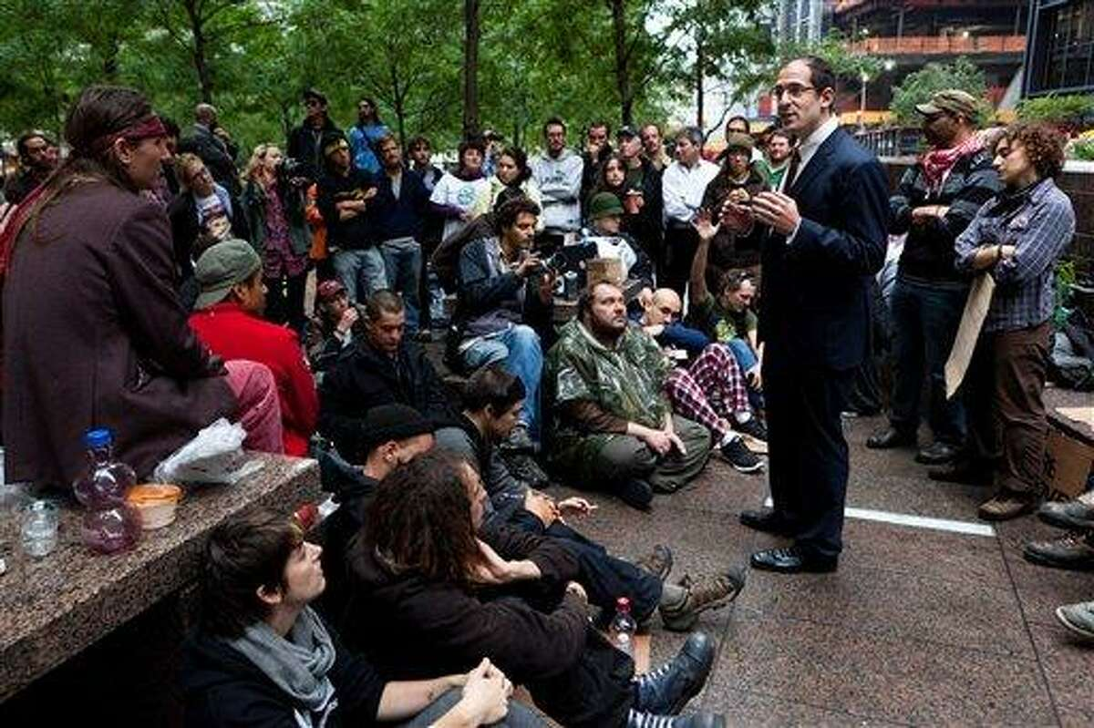 Attorney Samuel Cohen speaks at a meeting of Occupy Wall Street demonstrators to offer pro-bono legal representation from his firm, Wylie Law, Tuesday, Sept. 20, 2011, in the Manhattan borough of New York. The demonstrators, who have been camping overnight in nearby Zucotti park since Saturday, have been surrounded by police officers around the clock with at least 12 protestors arrested in recent days. (AP Photo/John Minchillo)