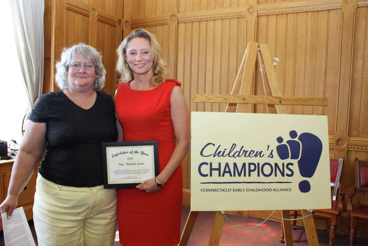 Submitted photo Rep. Michelle Cook, right, receives her honorary award from Torrington Early Childhood Collaborative director Mary Cecchinato.
