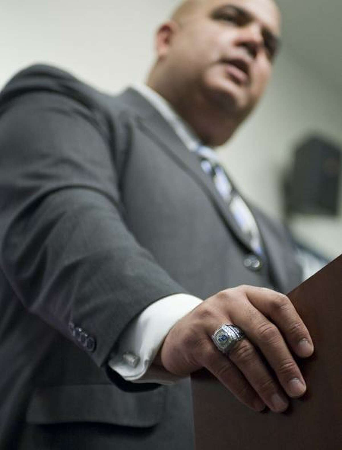 Former University at Buffalo Athletic Director Warde Manuel wears a championship ring from his former school as he is introduced as the new athletic director for the University of Connecticut at a news conference in Storrs, Conn., Monday, Feb. 13, 2012. (AP Photo/Jessica Hill)
