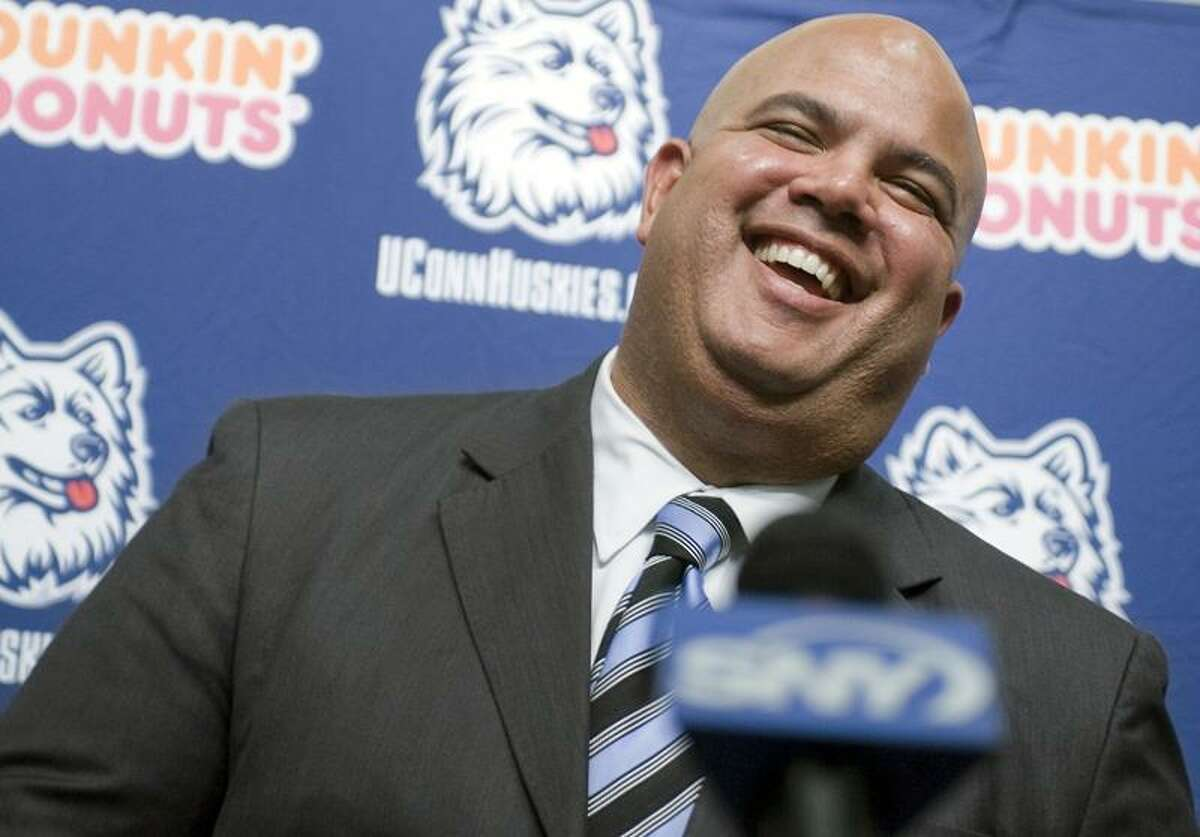 Warde Manuel smiles as he is introduced as the new athletic director for the University of Connecticut at a news conference in Storrs, Conn., Monday, Feb. 13, 2012. (AP Photo/Jessica Hill)