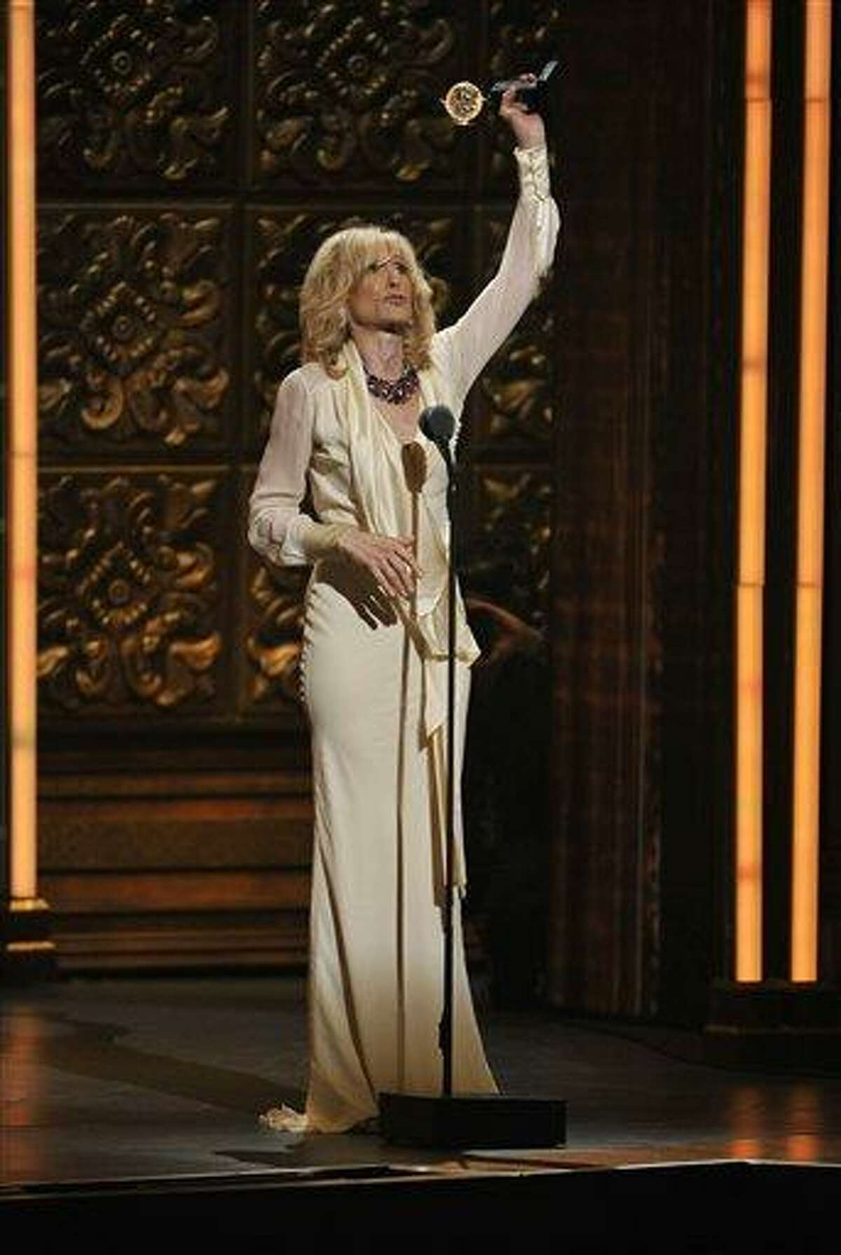 Judith Light accepts the award for best actress in a featured role in a play at the 66th Annual Tony Awards on Sunday June 10, 2012, in New York.