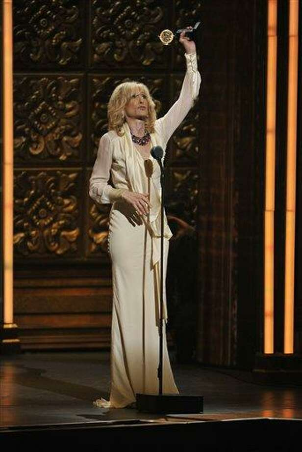 Judith Light accepts the award for best actress in a featured role in a play at the 66th Annual Tony Awards on Sunday June 10, 2012, in New York. Photo: CHARLES SYKES/INVISION/AP / Invision