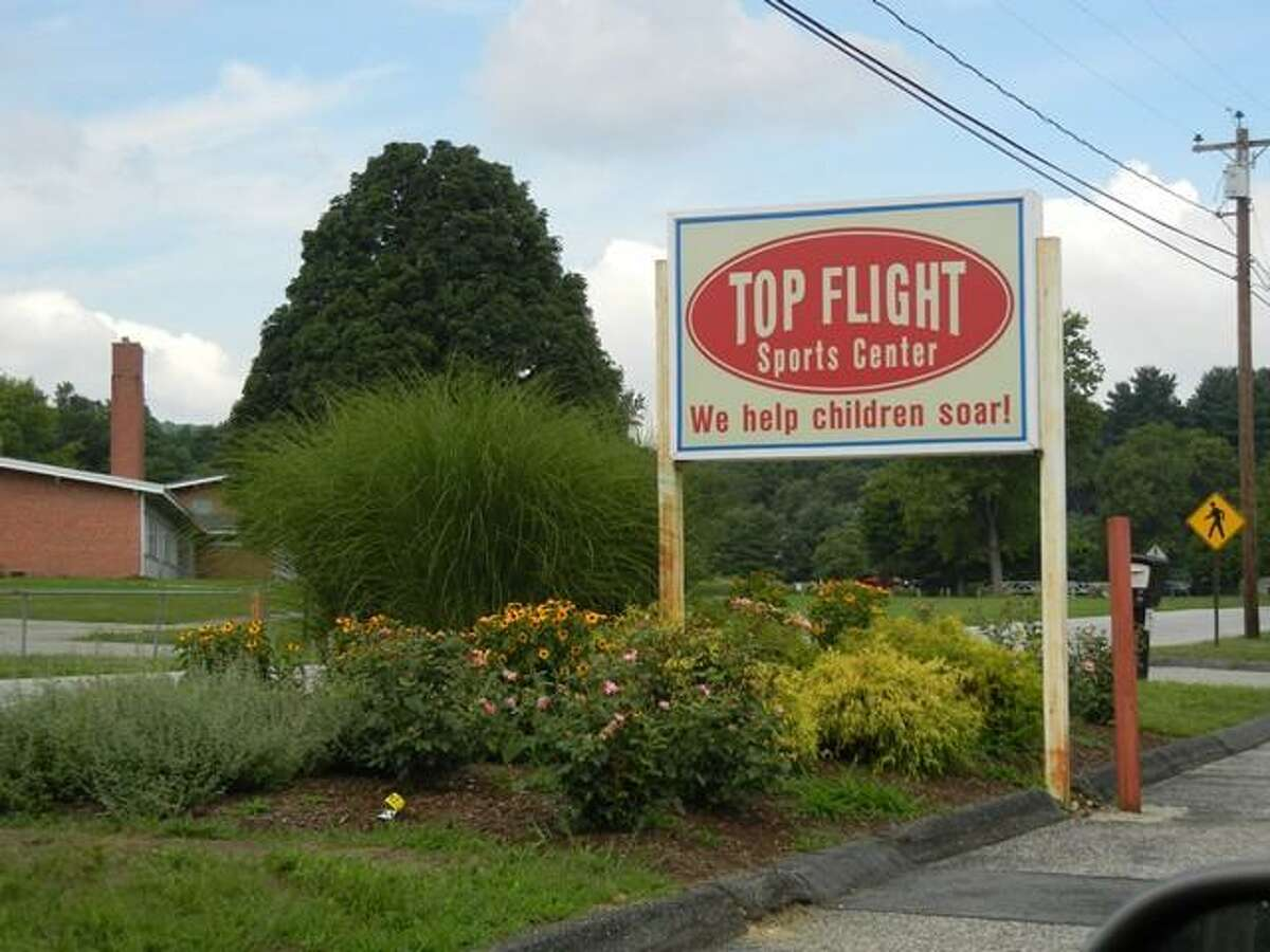 The sign outside Top Flight Sports Center on Pickett District Road in New Milford, across the road from the John Pettibone School. Photo by Alice Tessier.