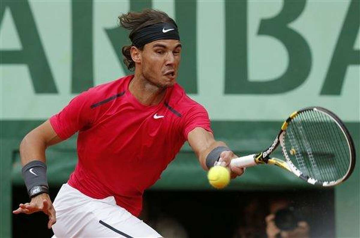 Spain's Rafael Nadal returns the ball to Serbia's Novak Djokovic during their men's final match in the French Open tennis tournament at the Roland Garros stadium Monday in Paris. Associated Press