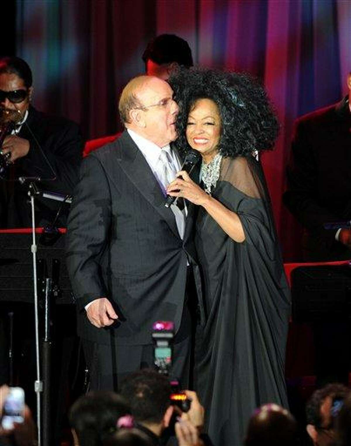 Clive Davis and Diana Ross speak onstage at the Pre-GRAMMY Gala & Salute to Industry Icons with Clive Davis honoring Richard Branson, Saturday in Beverly Hills, Calif. Associated Press