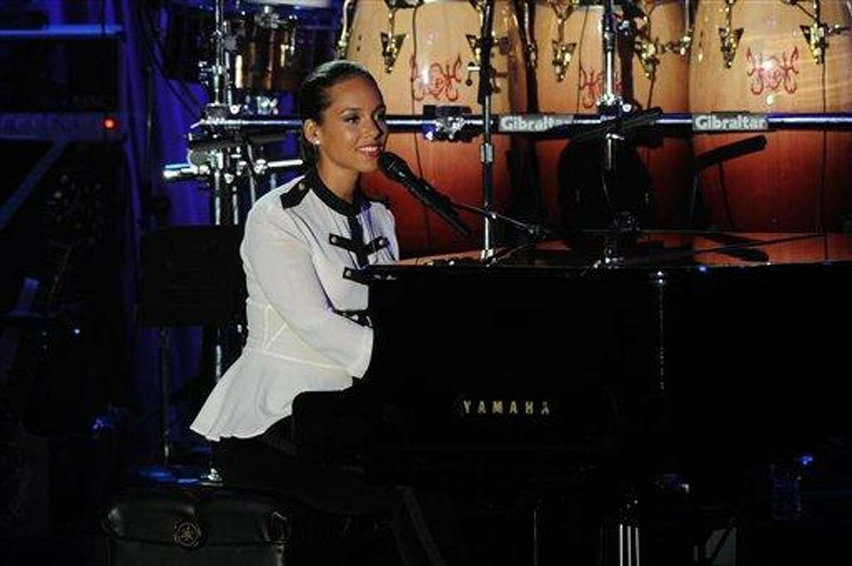 Alicia Keys performs onstage at the Pre-GRAMMY Gala & Salute to Industry Icons with Clive Davis honoring Richard Branson, Saturday in Beverly Hills, Calif. Associated Press