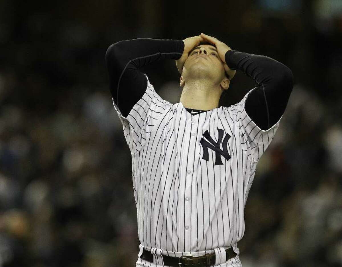 ASSOCIATED PRESS New York Yankees' Mark Teixeira reacts after temmate Nick Swisher struck out with bases loaded in the seventh inning in Game 5 of baseball's American League division series agisnt the Detroit Tigers Thursday in New York. The Yankees lost the game, 3-2, and the series.