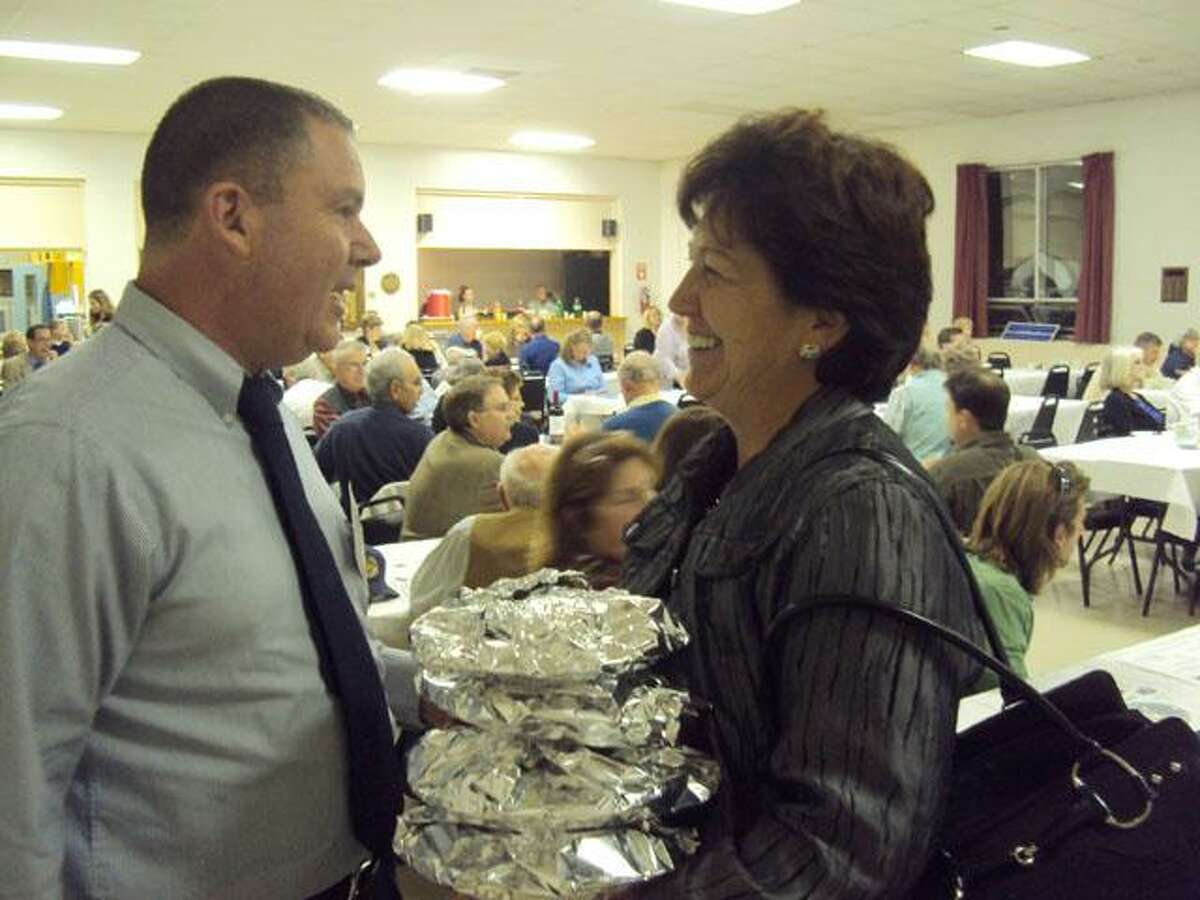 RICKY CAMPBELL/ Register Citizen Selectman Paul J. Parsons shares a laugh Thursday night with former probate judge and resident Helen Bunnell as she prepares to leave the Litchfield Republican Town Committee's Annual Pasta Supper. The event, organized by committee member Meredith Blake, provided a platform for committee members to serve the community and for candidates to meet potential voters.