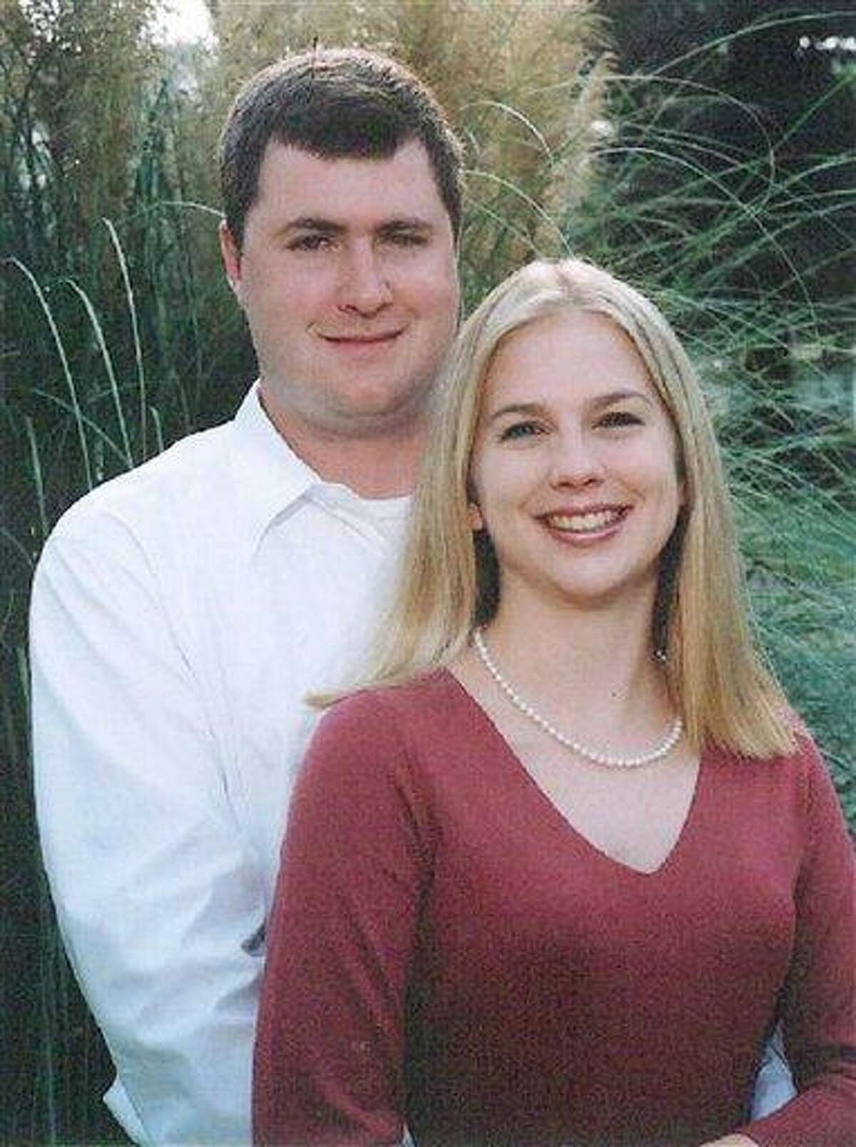 In this undated photo, Gabe Watson, left, and Tina Thomas, pose on their engagement. A judge will consider motions and begin jury selection Monday in Birmingham for the trial of Watson, who served prison time in Australia for the death of his bride during their honeymoon. She drowned during a scuba dive in Australia just days after her wedding in October 2003. Associated Press