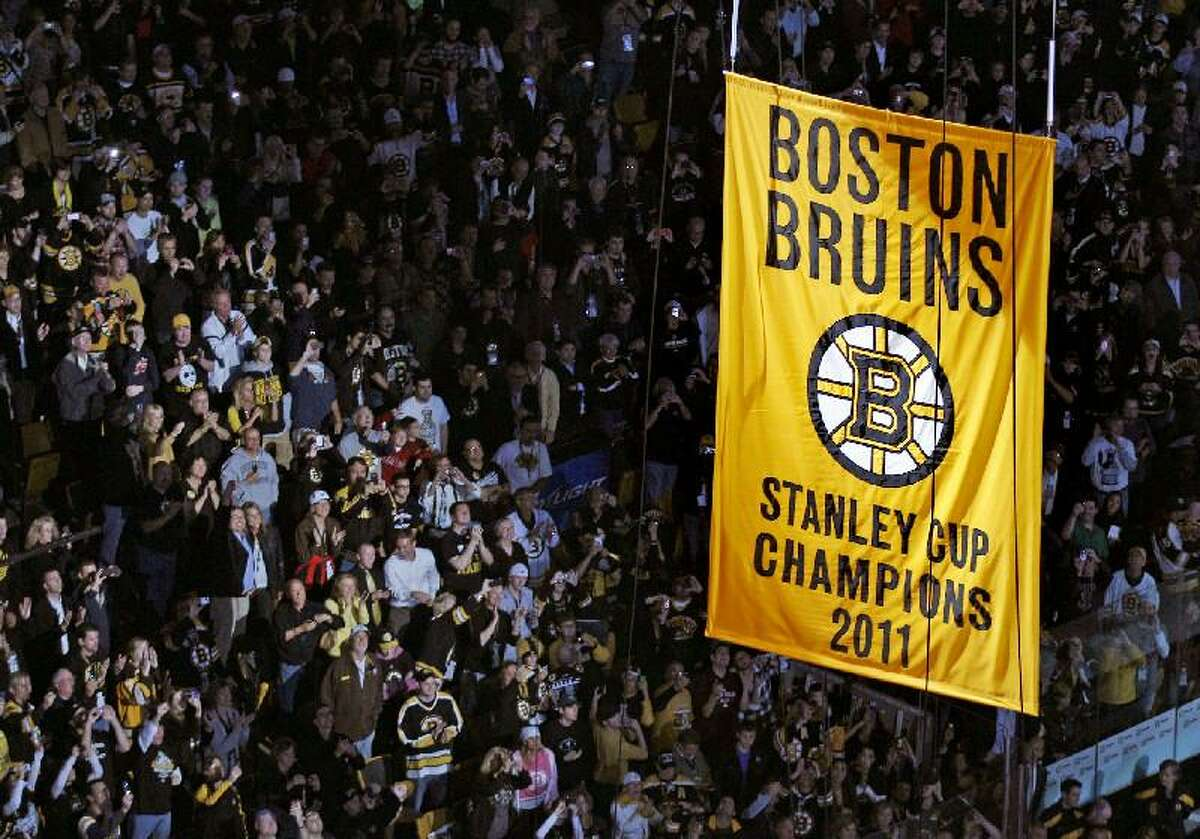 ASSOCIATED PRESS Fans applaud as the Stanley Cup banner is hoisted to the rafters of the Boston Garden prior to the Boston Bruins facing the Philadelphia Flyers in a game Thursday in Boston.
