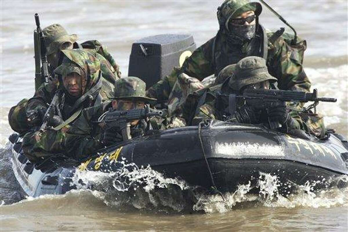 FILE - In this Feb. 25, 2011 file photo, South Korean marines on an inflatable boat aim their machine guns during a military exercise to prepare for a possible North Korea's surprise attack on the Han River in Gimpo, South Korea. North Korea's military threatened Sunday, Feb. 27, 2011 to fire at South Korea, as Seoul prepared to start annual joint drills with U.S. troops, maneuvers Pyongyang says are a rehearsal for an invasion. (AP Photo/Ahn Young-joon, File)