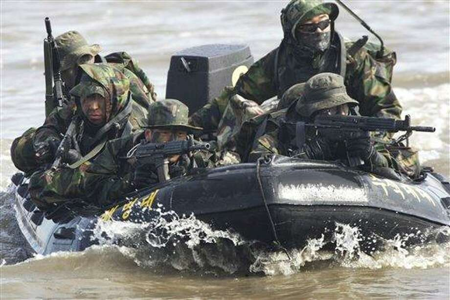 FILE - In this Feb. 25, 2011 file photo, South Korean marines on an inflatable boat aim their machine guns during a military exercise to prepare for a possible North Korea's surprise attack on the Han River in Gimpo, South Korea. North Korea's military threatened Sunday, Feb. 27, 2011 to fire at South Korea, as Seoul prepared to start annual joint drills with U.S. troops, maneuvers Pyongyang says are a rehearsal for an invasion. (AP Photo/Ahn Young-joon, File) Photo: AP / AP