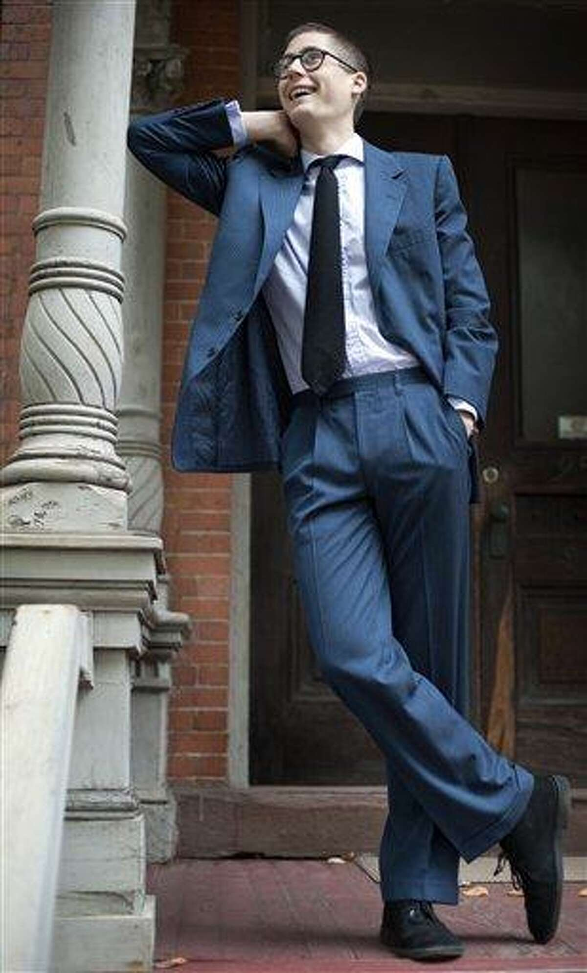 Peter Gamlen poses in a suit he found in the basement of his apartment. ASSOCIATED PRESS PHOTO