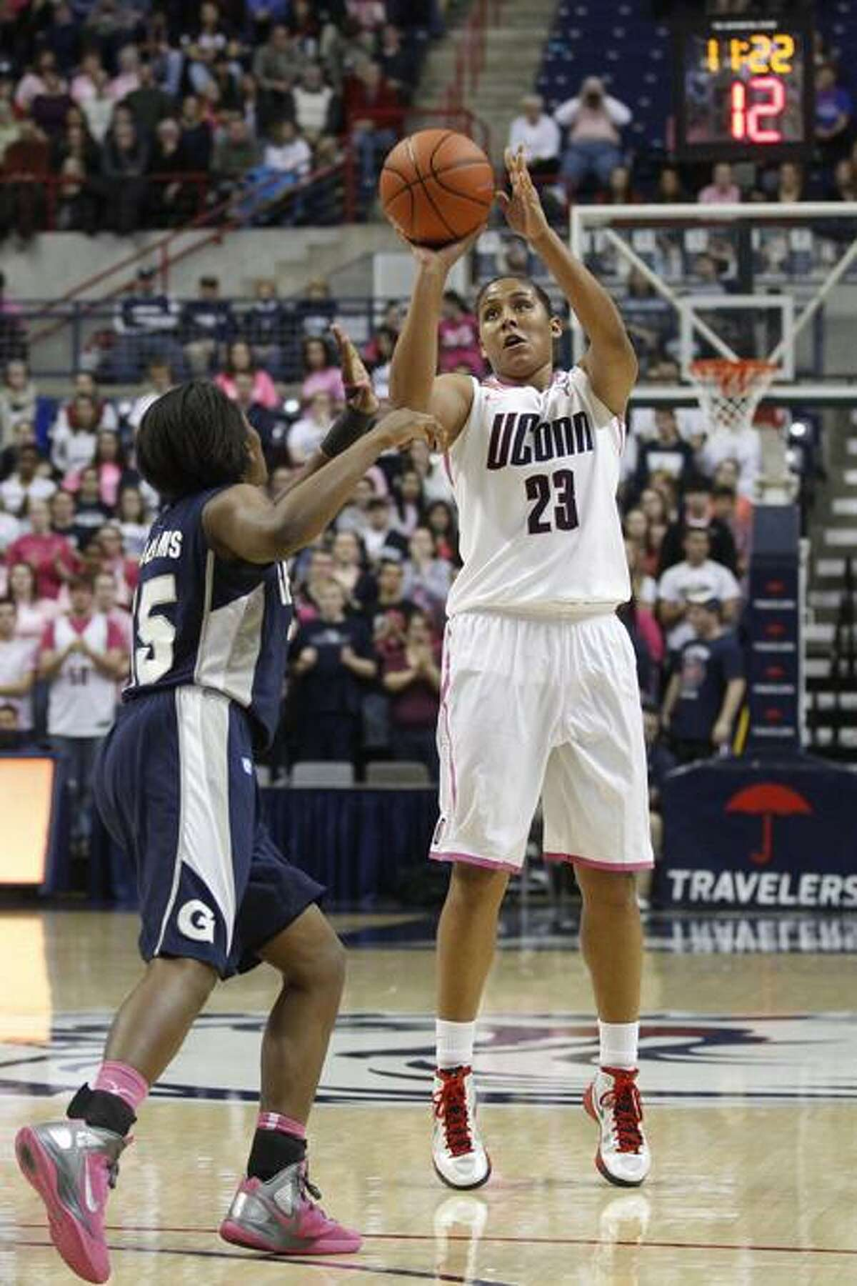 Feb 11, 2012; Storrs, CT, USA; Connecticut Huskies forward Kaleena Mosqueda-Lewis (23) shoots the ball in the second half against Georgetown Hoyas guard Morgan Williams (15) at Gampel Pavilion. UConn defeated the Georgetown Hoyas 80-38. Mandatory Credit: David Butler II-US PRESSWIRE