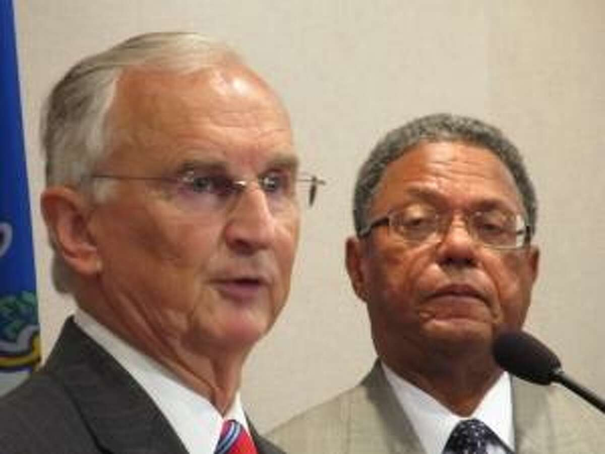 Photo courtesy of ctmirror.org Robert A. Kennedy (left), president of the Board of Regents, and Lewis Robinson Jr., chairman of the board.