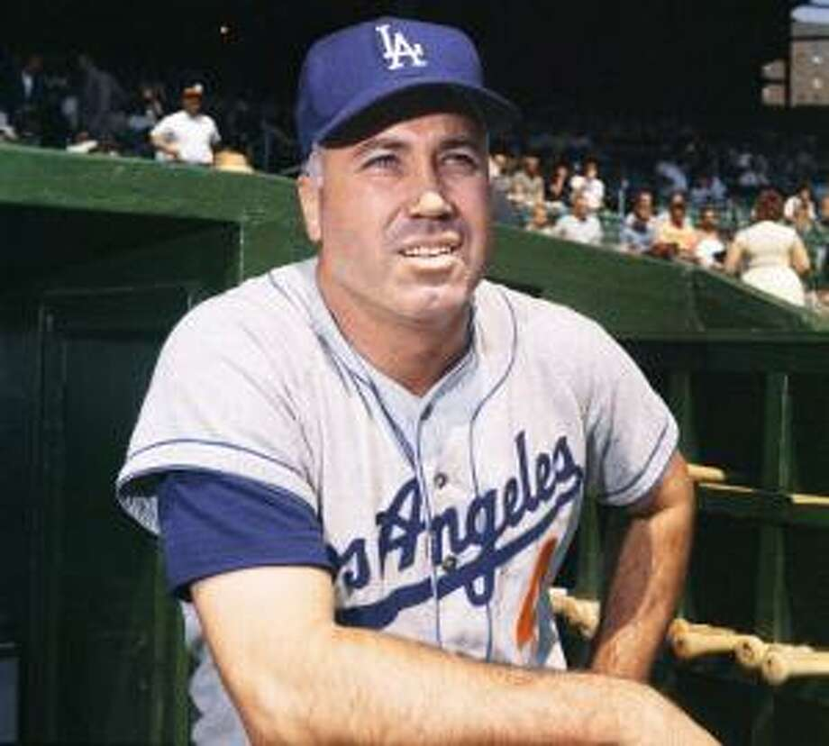 "AP In this August 1962, file photo, Los Angeles Dodgers outfielder Duke Snider poses at a baseball game, location not known. Snider, 84, died early Sunday of what the family called natural causes at the Valle Vista Convalescent Hospital in Escondido, Calif. Snider was part of the charmed ""Boys of Summer"" with the Dodgers in the late 1940s and 1950s. He helped lead Brooklyn to its only World Series championship in 1955."