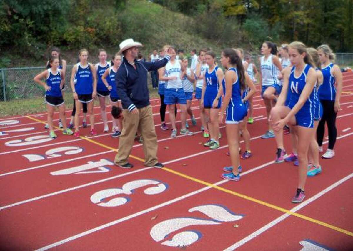 Nonnewaug coach Arleigh Duff lines up the competitors in Tuesday's Berkshire League girls race at Nonnewaug High School