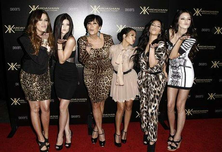 In this Aug. 17, 2011 file photo, from left, Khloe Kardashian, Kylie Jenner, Kris Jenner, Kourtney Kardashian, Kim Kardashian, and Kendall Jenner arrive at the Kardashian Kollection launch party in Los Angeles. The Kardashians will visit Oprah Winfrey when 'Oprah's Next Chapter' airs this Sunday, June 17 at 8p.m. EST on OWN. Photo: AP / 2011 AP