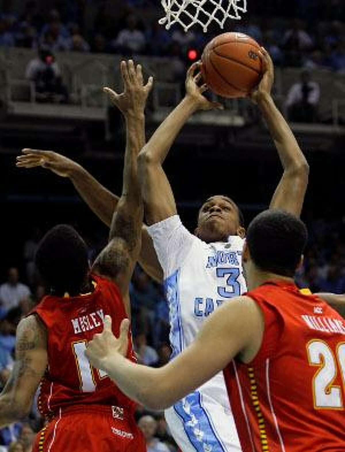 AP North Carolina's John Henson shoots as Maryland's Sean Mosley and Jordan Williams, right, defend during the first half of Sunday's game in Chapel Hill, N.C. Williams had 16 points and a career-high 19 rebounds The Tar Heels defeated the Terrapins 87-76.