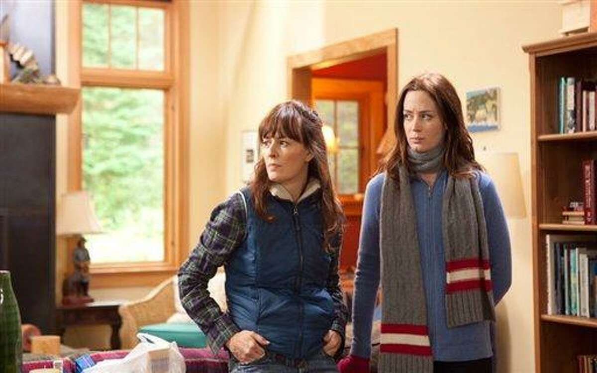 This film image released by IFC Films shows Rosemarie DeWitt, left, and Emily Blunt in a scene from