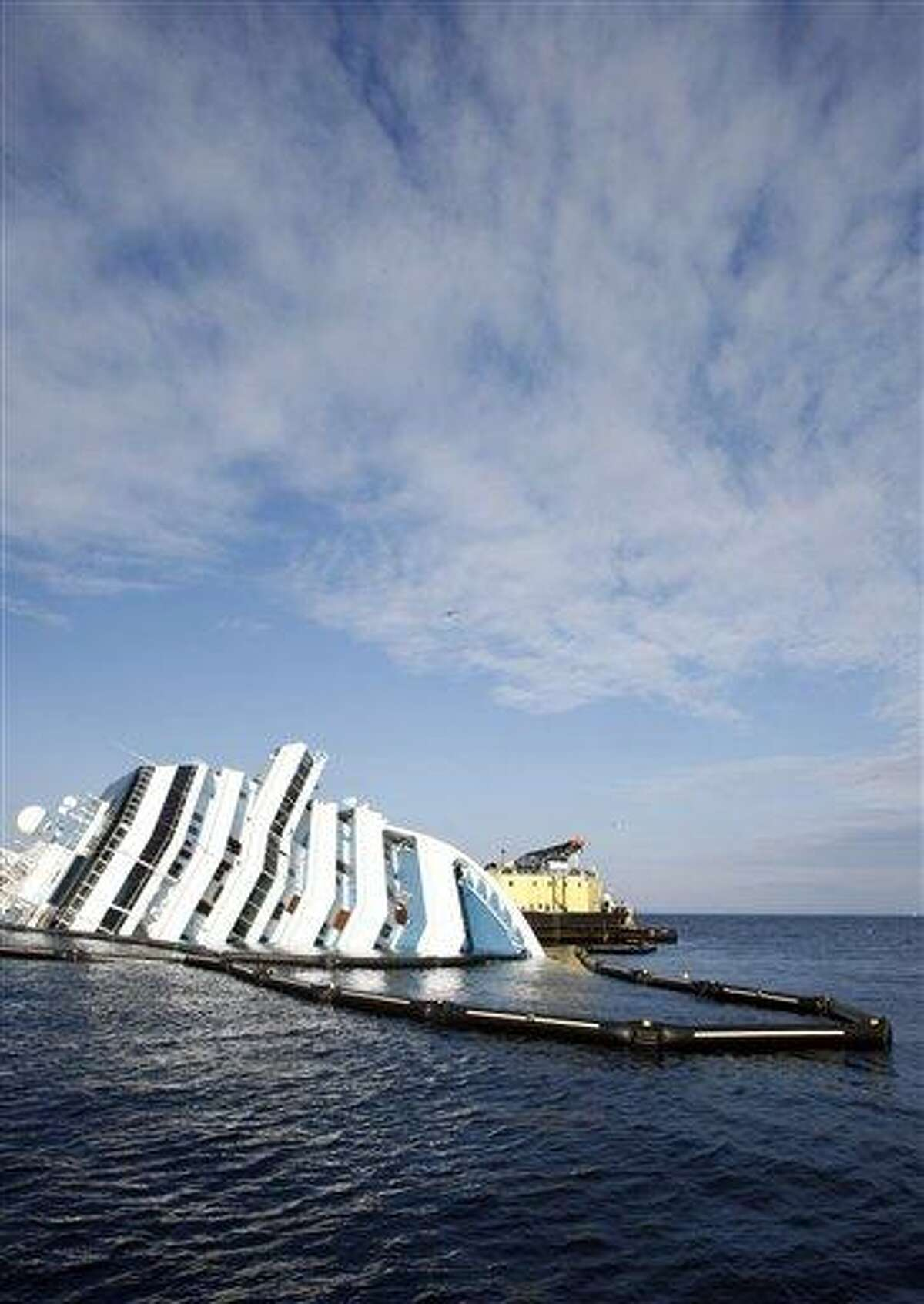 An anti-oil spilling barrier floats around the grounded cruise ship Costa Concordia off the Tuscan island of Giglio, Italy, this week. The Concordia ran aground Jan. 13 after the captain deviated from his planned route and gashed the hull of the ship on a reef. The ship contains about 500,000 gallons (2,400 tons) of heavy fuel and other pollutants. Associated Press