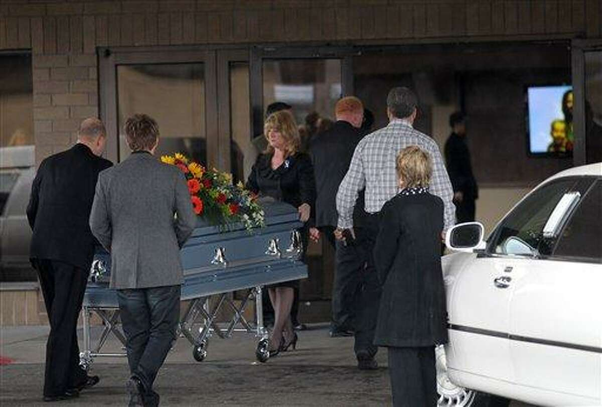 A casket with the bodies of Charlie and Braden Powell, ages 7 and 5, is wheeled into Life Center Church in Tacoma Saturday. The family of missing Utah woman Susan Powell is holding a public funeral for her two sons, nearly a week after their father killed them in a gas-fueled blaze. Associated Press