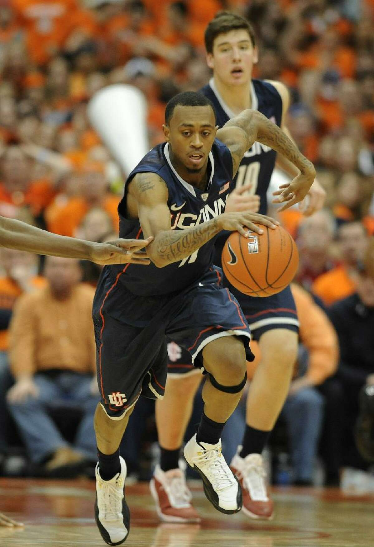 ASSOCIATED PRESS Connecticut's Ryan Boatright dribbles down the court during Saturday's game against Syracuse at the Carrier Dome in Syracuse, N.Y. The Huskies lost 85-67.