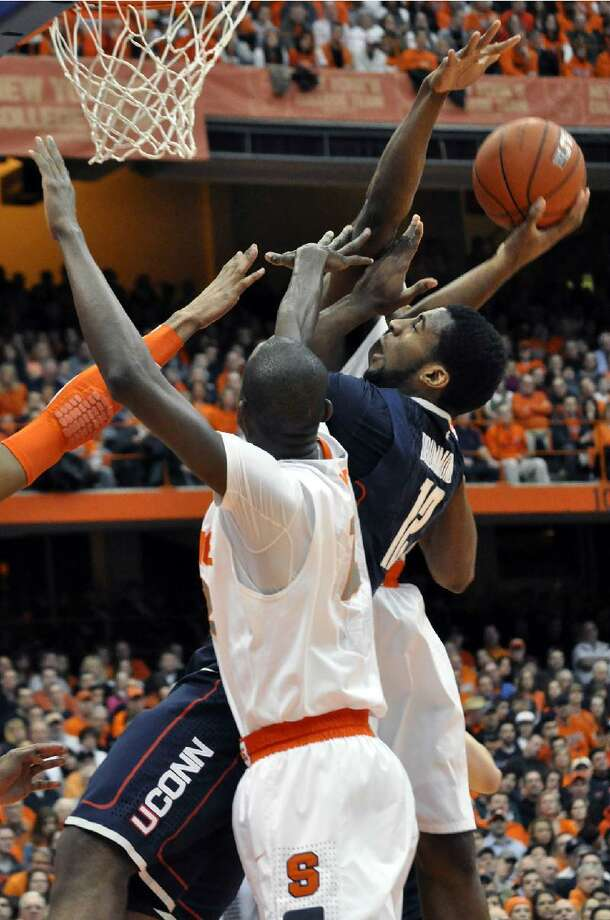ASSOCIATED PRESS  Connecticut's Andre Drummond tries to score between Syracuse defenders during the first half of Saturday's game at the Carrier Dome in Syracuse, N.Y. The Huskies lost 85-67.