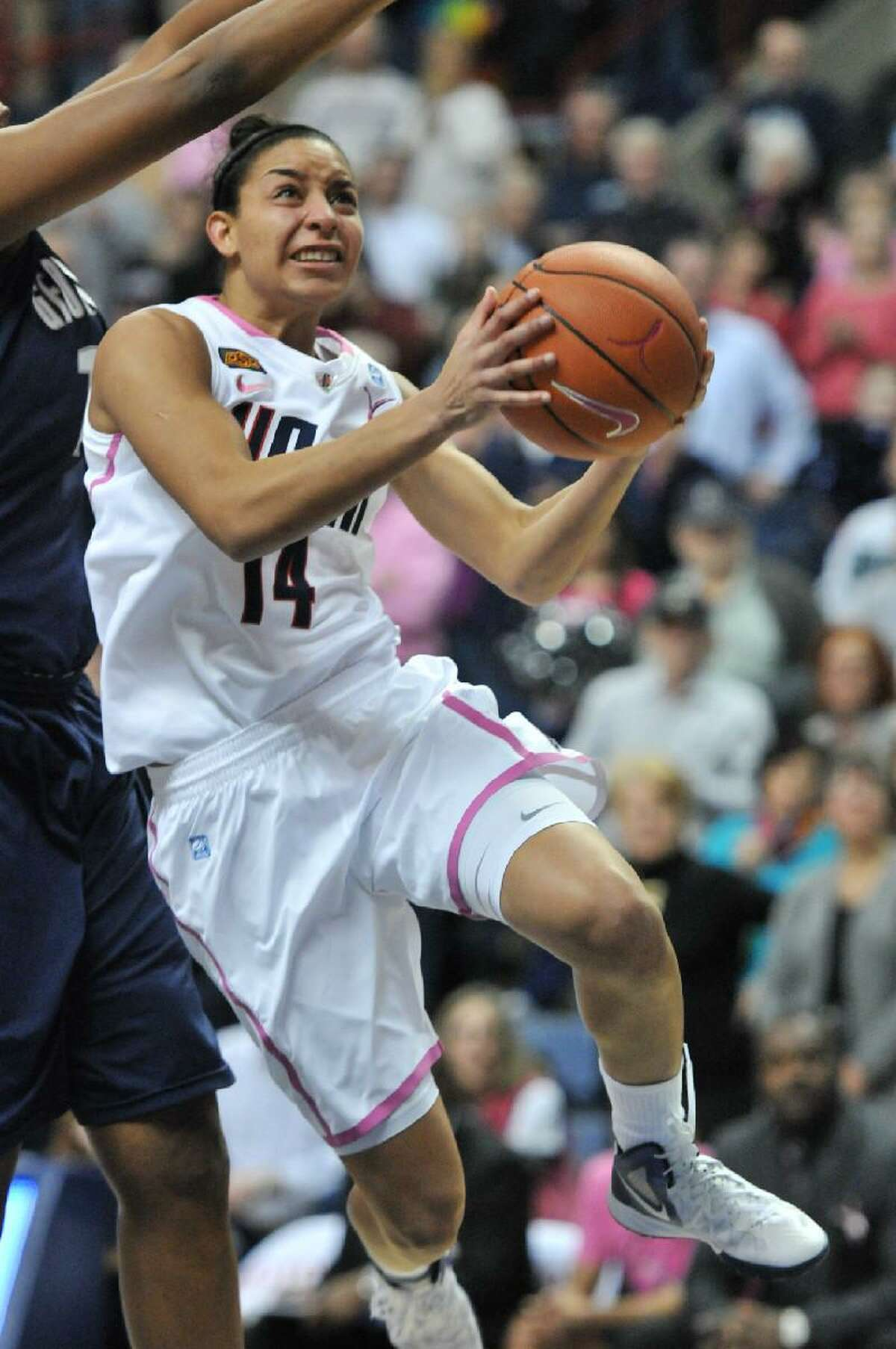 ASSOCIATED PRESS Connecticut's Bria Hartley makes her move to the basket during Saturday's game against Georgetown at Gampel Pavilion in Storrs. The Huskies won 80-38 to extend their home winning streak to 99 straight homes.