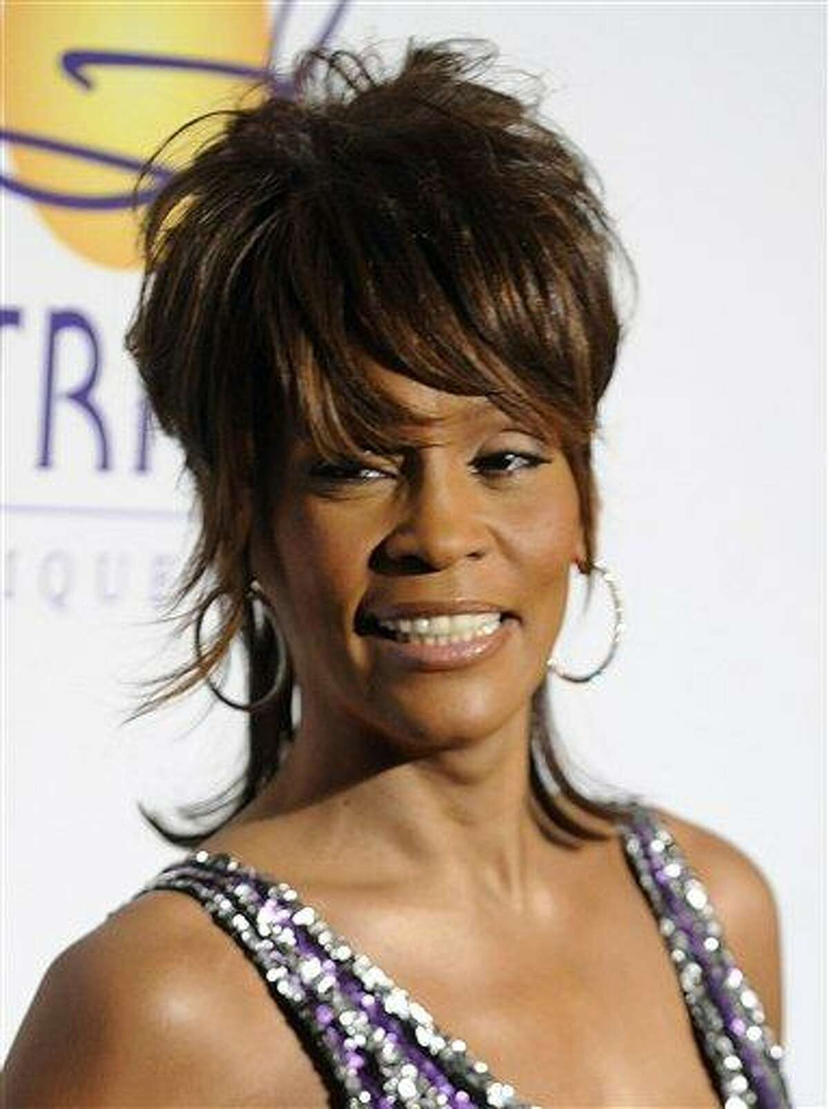 FILE - In this Feb. 9, 2008 file photo, singer Whitney Houston arrives at the Clive Davis Pre-Grammy Party in Beverly Hills, Calif. Whitney Houston, who reigned as pop music's queen until her majestic voice and regal image were ravaged by drug use, has died, Saturday, Feb. 11, 2012. She was 48. (AP Photo/Chris Pizzello, file)