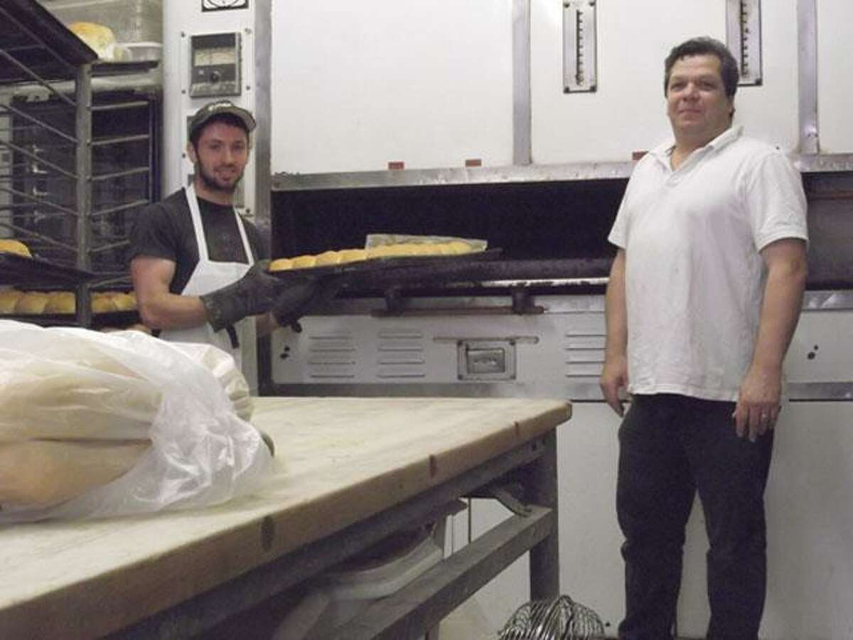 RICKY CAMPBELL/ Register CitizenFrank Madia and John Parent of The Bake Shoppe, 280 East Main St., won't continue their special bread and cookie recipes for much longer. Madia was given his layoff notice because Parent's store is unable to continue production due to slowing business.