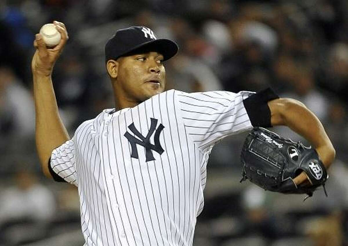 New York Yankees' Ivan Nova throws to the Detroit Tigers in the ninth inning during the continuation of Game 1 of baseball's American League division series on Saturday, Oct. 1, 2011, at Yankee Stadium in New York. The Yankees won 9-3. (AP Photo/Kathy Kmonicek)