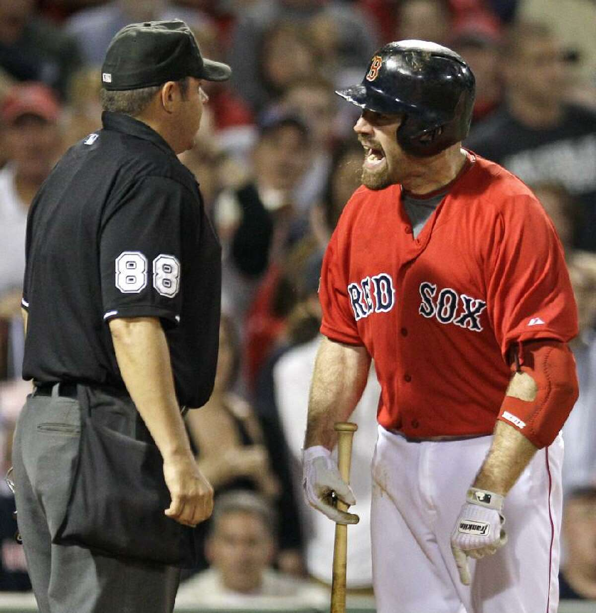 ASSOCIATED PRESS Boston Red Sox third baseman Kevin Youkilis argues with home plate umpire Doug Eddings after being called out looking with the bases loaded against the Washington Nationals in the sixth inning of Friday night's game at Fenway Park in Boston. Youkilis was ejected during the argument.