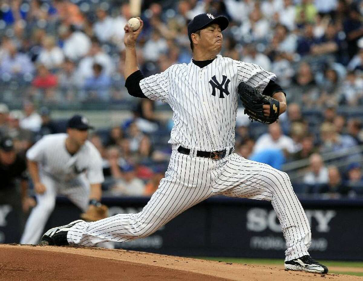 ASSOCIATED PRESS New York Yankees pitcher Hiroki Kuroda delivers during the first inning of an interleague game against the New York Mets on Friday at Yankee Stadium in New York. The Yankees beat the Mets 9-0.