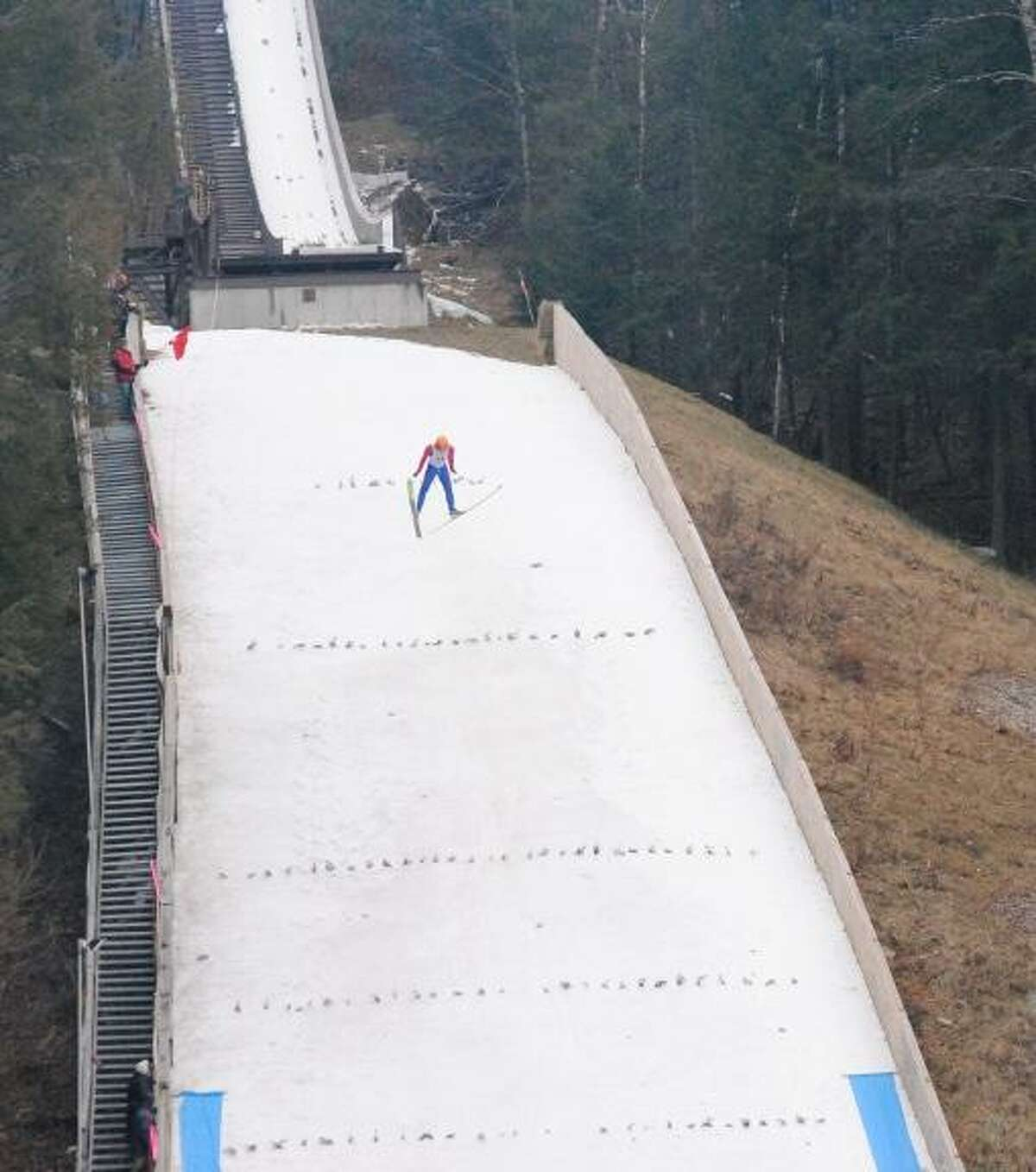 MIKE AGOGLIATI/Register Citizen Skier Chris Jones heads down the mountain for his jump at Jump Fest, held this weekend at Satre Hill in Salisbury.
