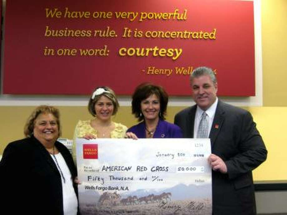 From left: Lucille Harriman, Kim Daur Dianne Auger and Kent McClun. Check presentation to American Red Cross February 1, 2011.