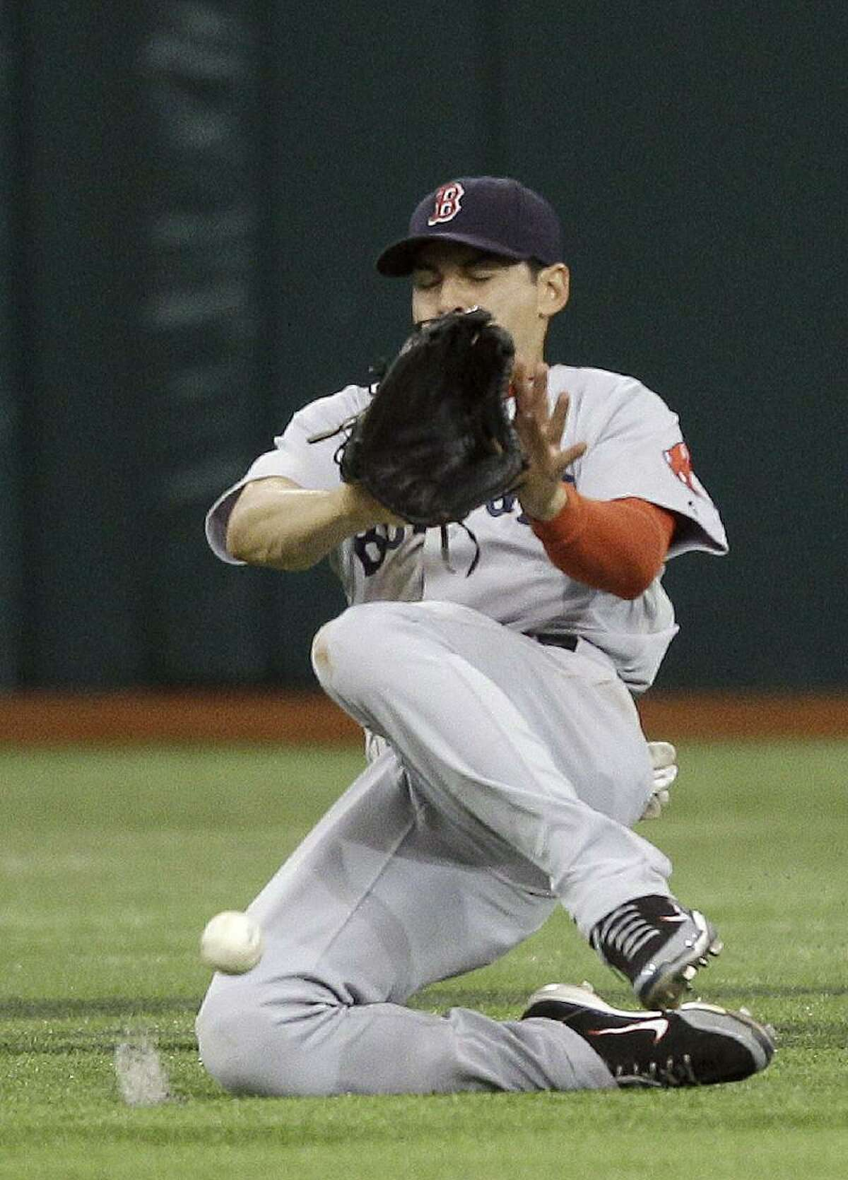 ASSOCIATED PRESS Boston Red Sox center fielder Jacoby Ellsbury slides but can't come up with an eighth-inning double by Tampa Bay'S Matt Joyce during Tuesday's game in St. Petersburg, Fla. Tampa Bay won 4-0.