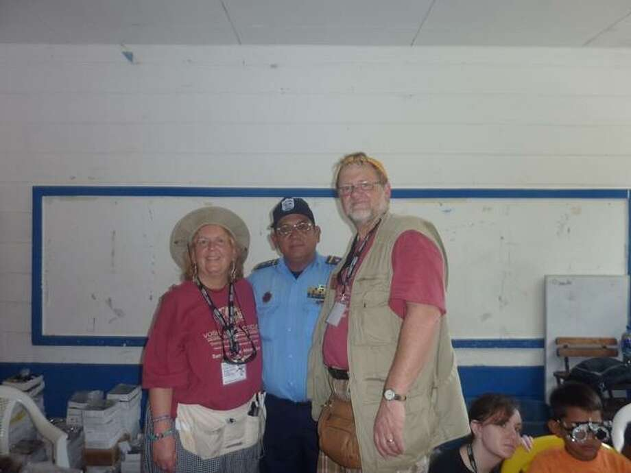 Dr. Matthew Blondin and his wife Audrey Blondin of Litchfield, whose practices are in Torrington, pose with a local official who came for an eye exam during the 14th annual VOSH-CT charitable trip to Nicaragua, where a group of visiting doctors provided a week of free eye care clinics to needy residents.