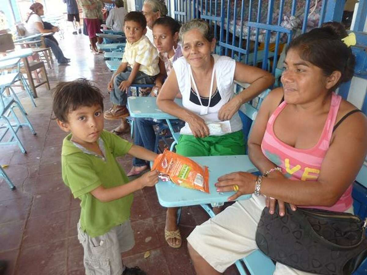 Residents wait to be seen during the 14th annual VOSH-CT charitable trip to Nicaragua, where doctors provided a week of free eye care clinics to needy residents.