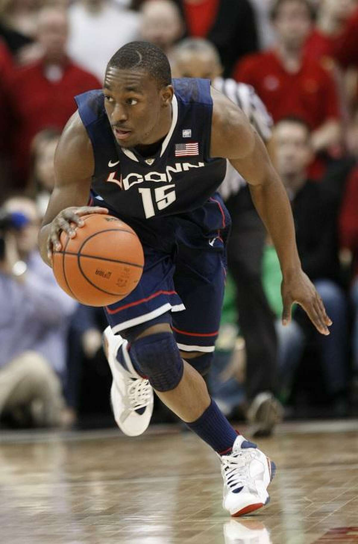 Connecticut 's Kemba Walker drives the ball upcourt during the first half of their NCAA college basketball game against Louisville in Louisville, Ky., Friday, Feb. 18, 2011. (AP Photo/Ed Reinke)