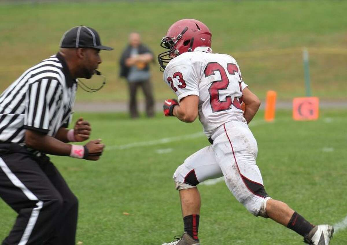 Marianne Killackey Nick Lorenzo (#23) of the Raiders scores a touchdown in Torrington's victory over St. Paul's Catholic on Saturday.
