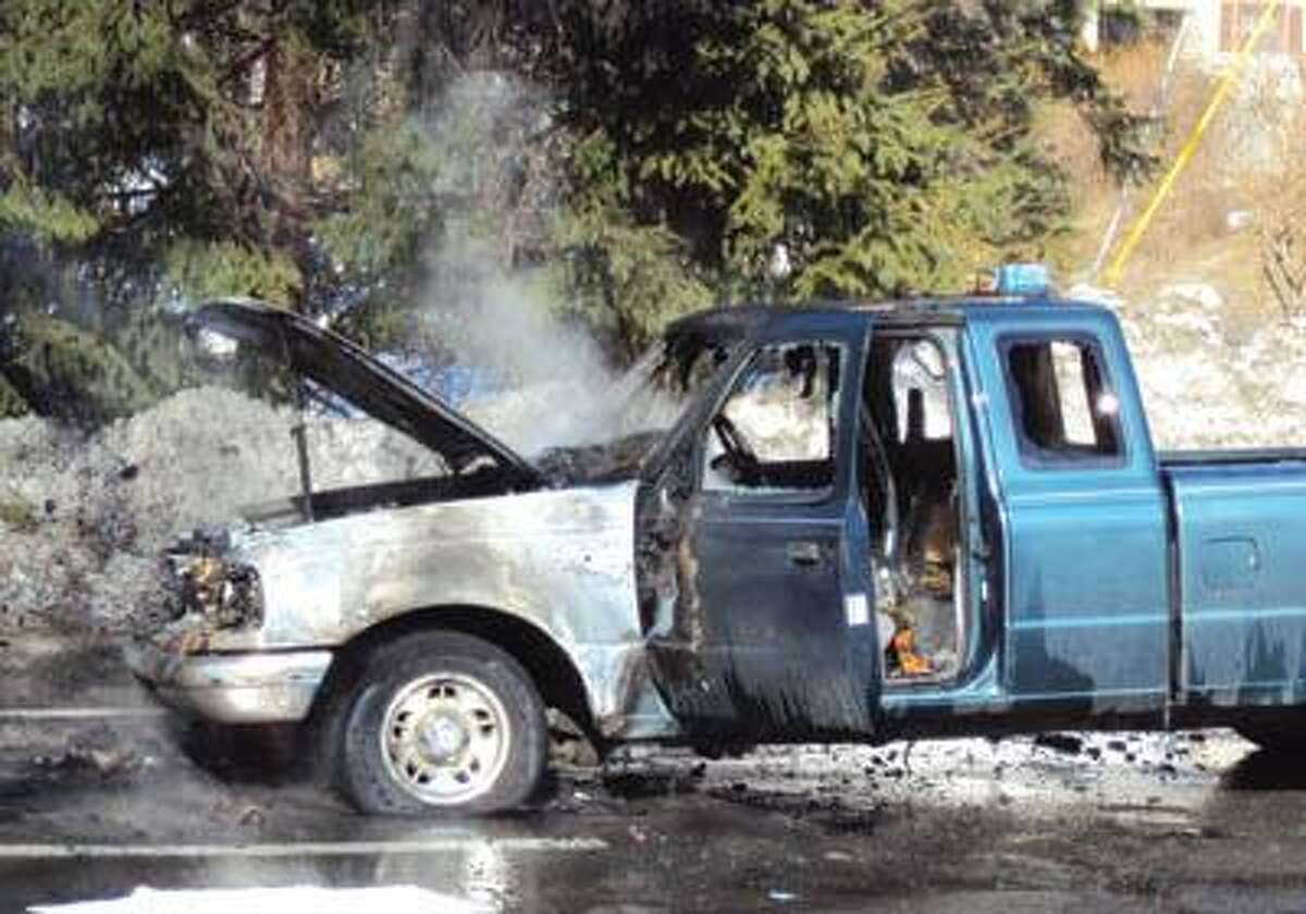 Ricky Campbell/Register Citizen.Ford Pick-up that caught fire at Cumberland Farms on Migeon Ave. in Torrington Thursday morning.