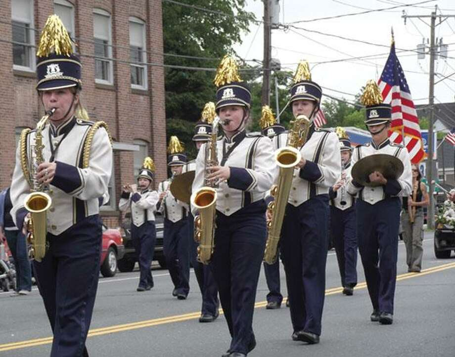 RICKY CAMPBELL/ Register CitizenGilbert High School's marching band takes the street during the Laurel Festival Parade in Winsted Sunday afternoon.