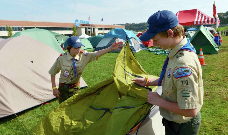 Boy Scouts Camden Fowler, left, and Matt Hess, right, of Troop 70 in Newtowne pitch a tent during the 11th annual Camp Sikorsky on the grounds of the main Sikorsky plant in Stratford.