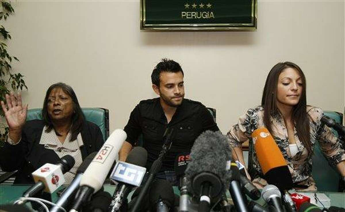 From left, Arline Kercher, Lyle Kercher and Stephanie Kercher, respectively mother, brother and sister of slain student Meredith Kercher, attend a news conference in Perugia, Italy, Tuesday, Oct. 4, 2011. The brother of slain British student Meredith Kercher says the family feels it is back to