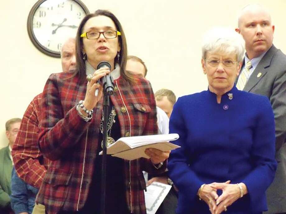RICKY CAMPBELL/ Register Citizen An area citizen expresses her concerns of Governor Malloy's proposed budget Thursday night at Torrington's City Hall. To the right, moderating the inquiries is Lt. Governor Nancy Wyman.
