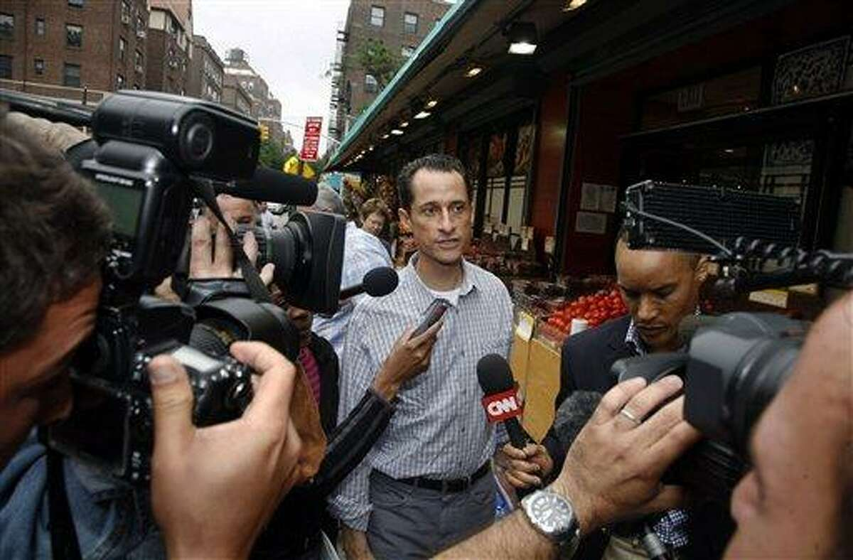 Rep. Anthony Weiner, D-N.Y., is questioned by the media near his home in the Queens borough of New York, Saturday, June 11, 2011. The 46-year-old congressman acknowledged Friday that he had online contact with a 17-year-old girl from Delaware but said there was nothing inappropriate. (AP Photo/David Karp)