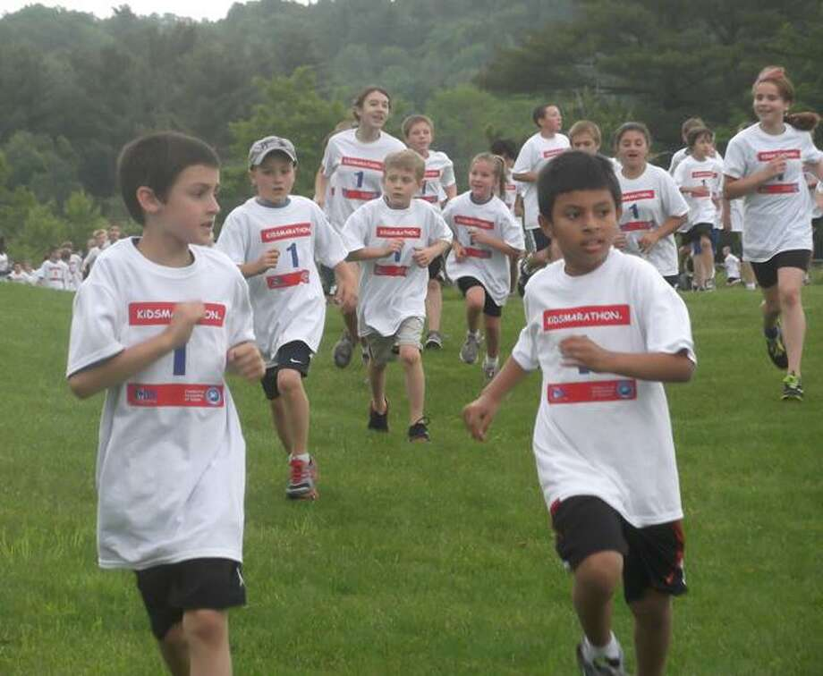 RICKY CAMPBELL/Register Citizen Children take off for the final mile of their fitness challenge, the KidsMarathon, at Litchfield's Plumb Hill Fields on Saturday.