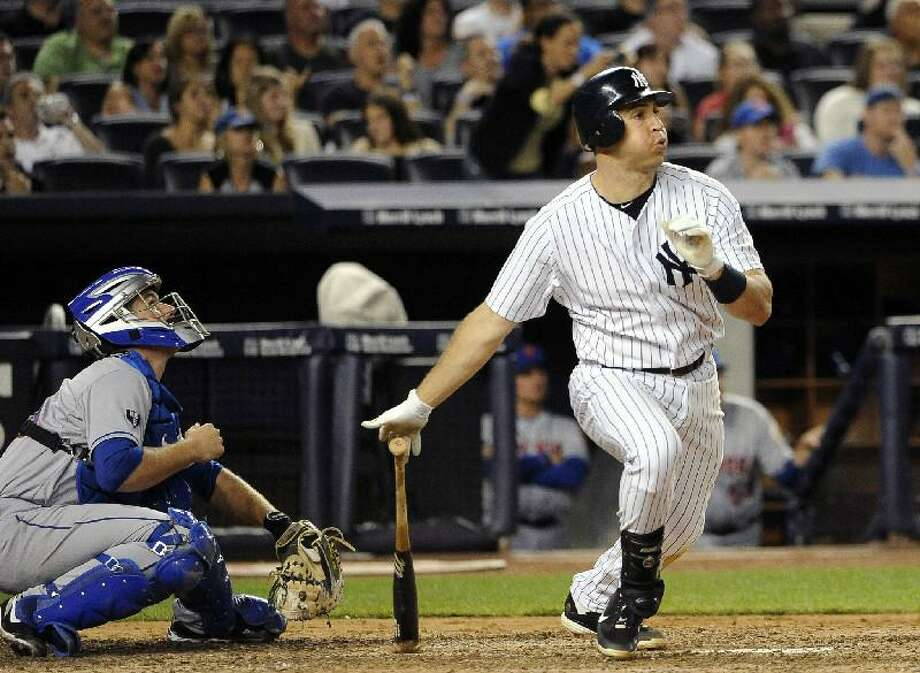 ASSOCIATED PRESS New York Mets catcher Josh Thole, left, watches as New York Yankees first baseman Mark Teixeira, right, hits a two-run home run off Mets starting pitcher Dillon Gee in the sixth inning of Saturday's game at Yankee Stadium in New York.