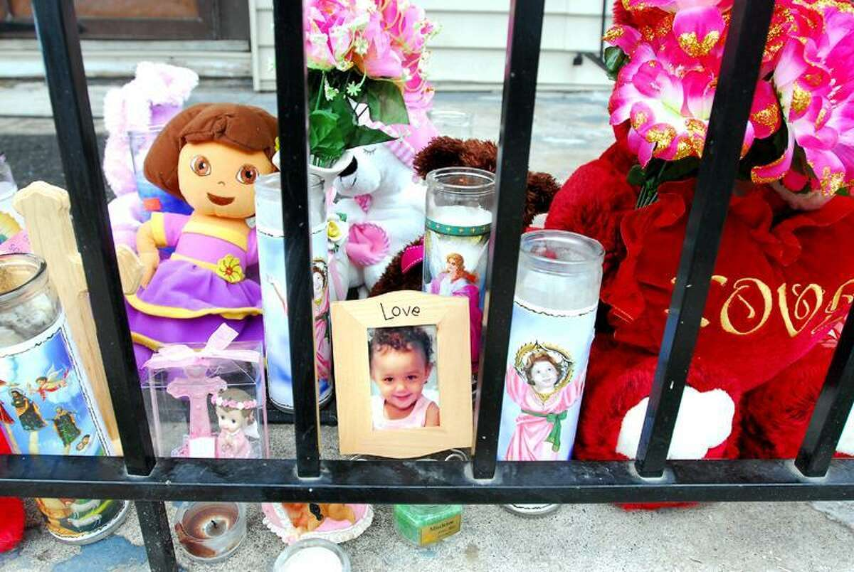 A memorial for Nevaeh Angel Bryant sits on the porch of 127 Leete St. in West Haven Monday.(Arnold Gold/New Haven Register)